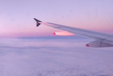 The sun rising as we arrive in Melbourne.