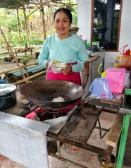 Kuey Teow chef on her front porch kitchen.