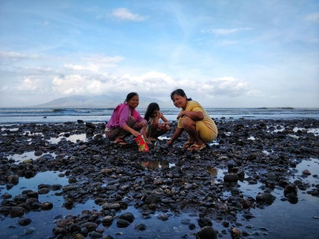 Local ladies collecting mussels on Cacalan Beach.